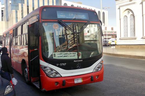 SAPTCO local service bus waiting for passengers at Balad