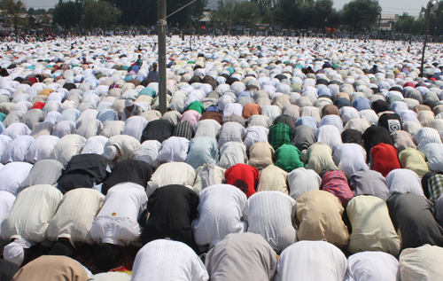 Muslims Pray on the Occasion of Eid al-Fitr